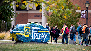 Cedarville's rock painted with CU Friday logo