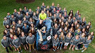 The Campus Experience department smiles by the Cedarville rock