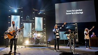 Worship band leads students in chapel