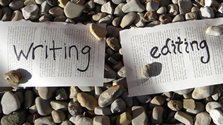 Paper saying writing and editing on rocks