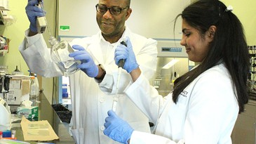 Pharmacy professor and student working in lab