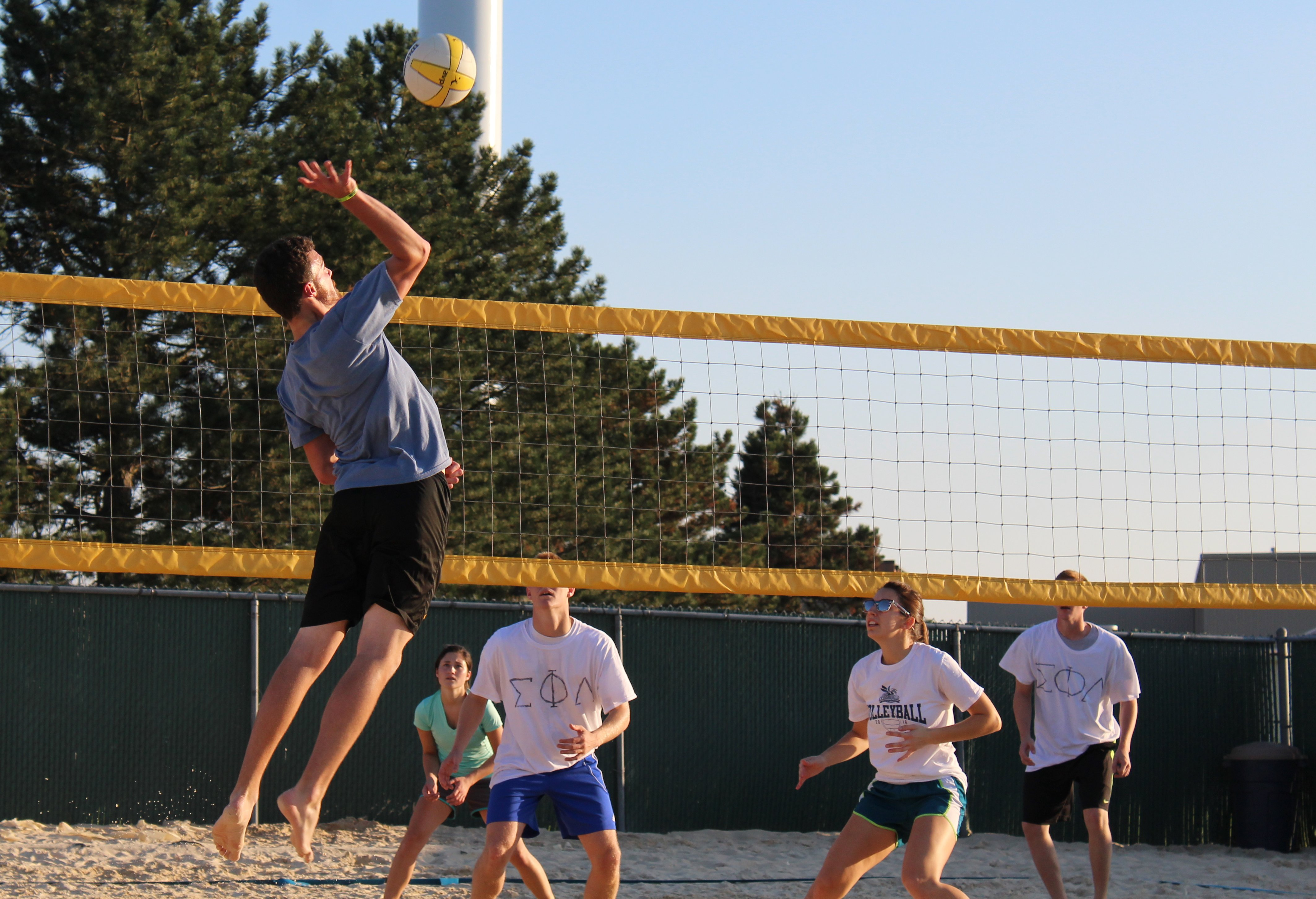 Students participate in sand volleyball