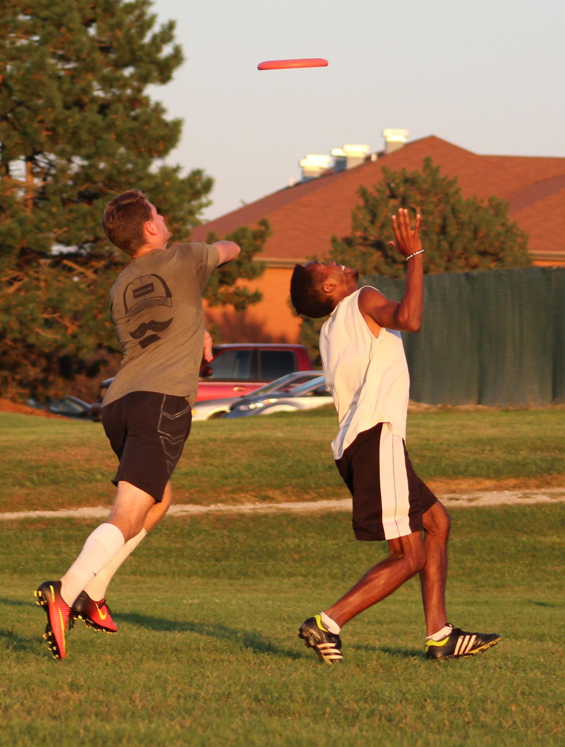 Two students catch an ultimate frisbee
