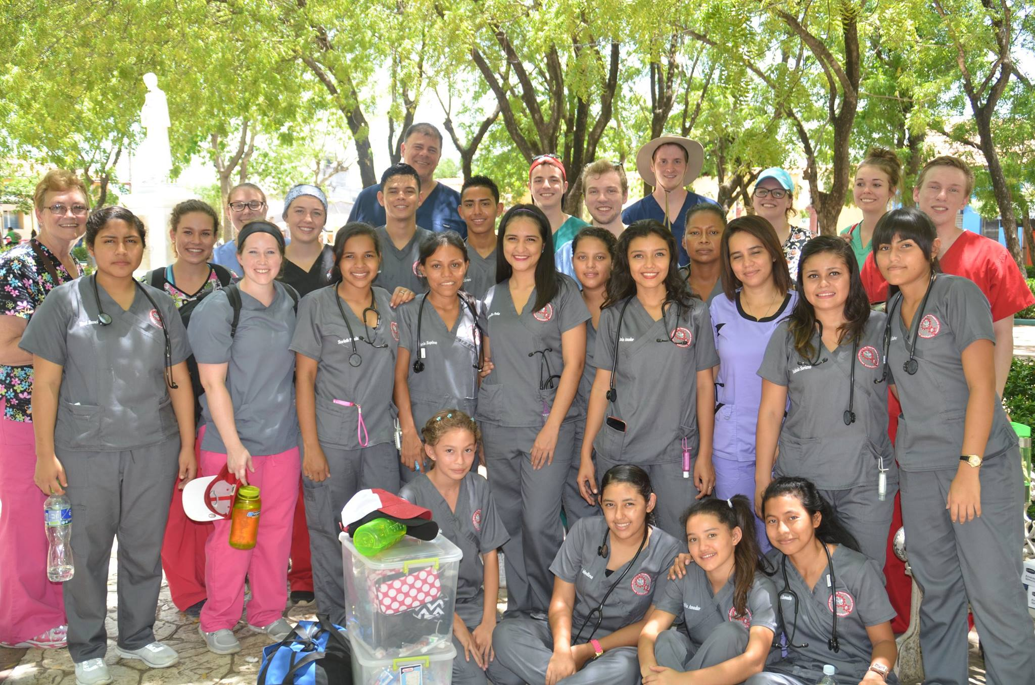 A group of Honduran nurses stand with Cedarville pharmacy students