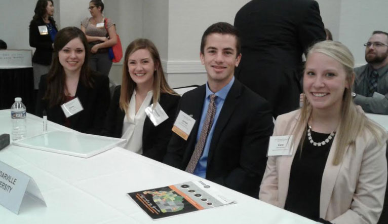 Cedarville pharmacy students sit at their competition table