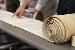 Torah scroll rolled out on the table