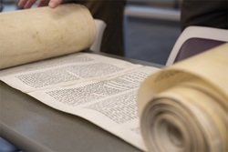 Torah scroll on table