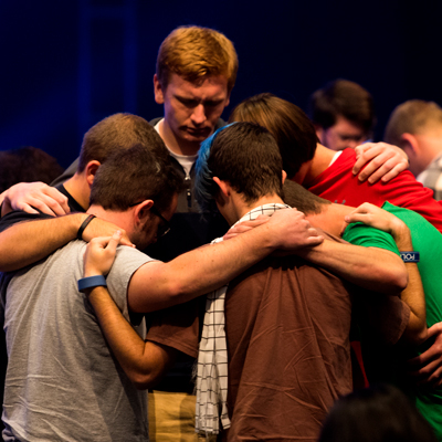 Group of students prays together