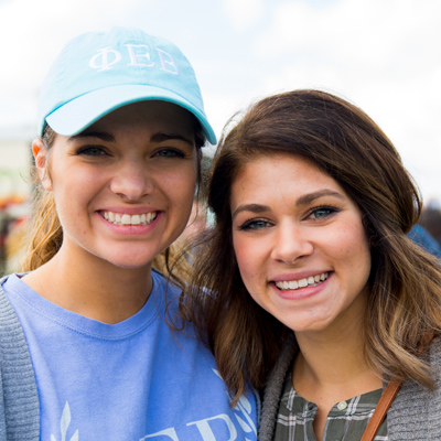 Two female students smiling