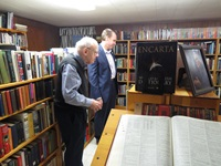 Drs. Warren Wiersbe and Thomas White looking over the Wiersbe library collection.