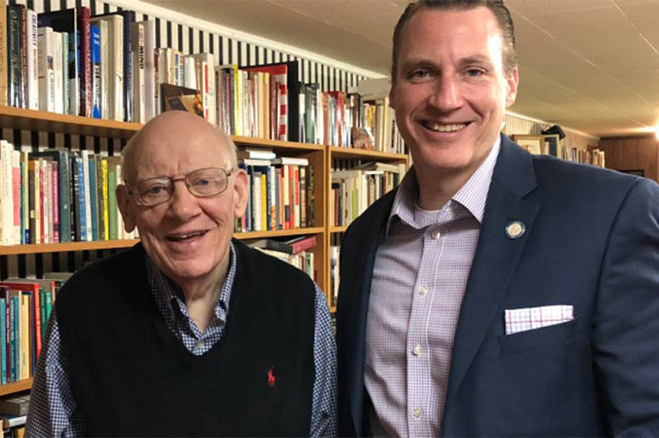 Dr. Warren Wiersbe and Dr. Thomas White smiling in Dr. Wiersbe's home library