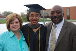 Family with graduating daughter in cap and gown