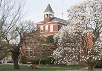 Founders Hall with flowering trees in the spring