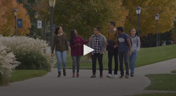 Video screenshot with students walking on campus