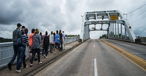 Students walking across the Edmund Pettus Bridge