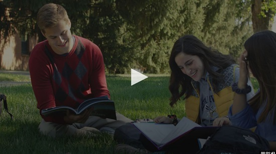 Video screen shot of student studying in grass