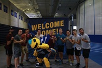 Students pose with Stinger during Getting Started