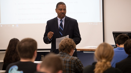 Dr. Patrick Oliver presenting in a classroom