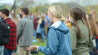 Students attending chapel outside.
