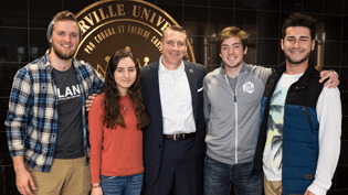 Cederville University President Dr. White with four students