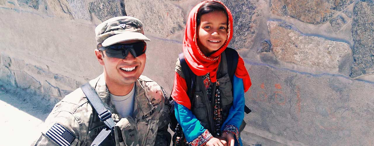 Ankit Pandav pictured in uniform with Afghan girl
