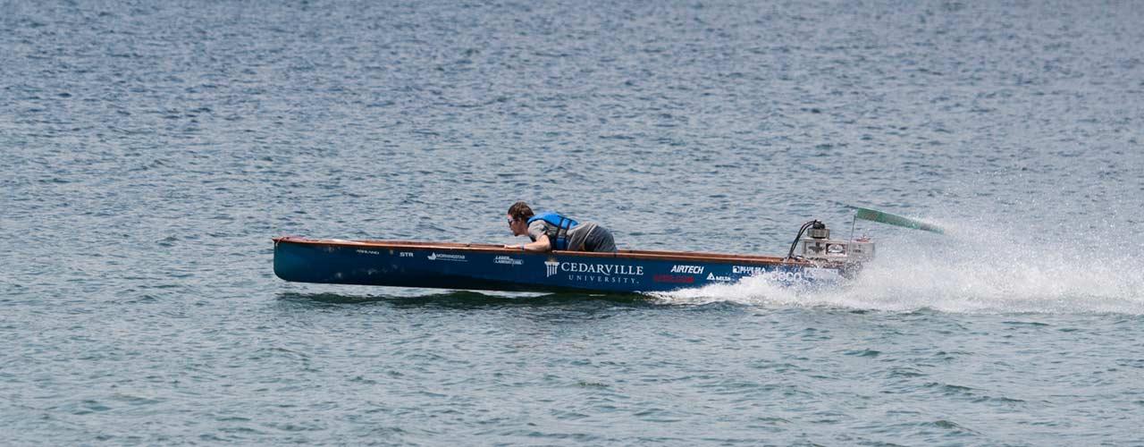 engineering student drives solar boat