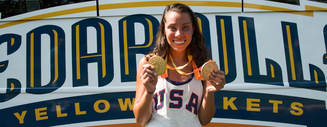 Grace Norman holding medals