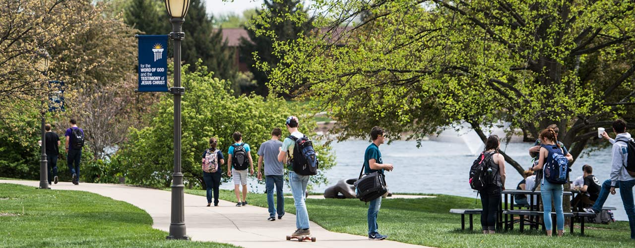 Students walk near Cedar Lake on campus of Cedarville University