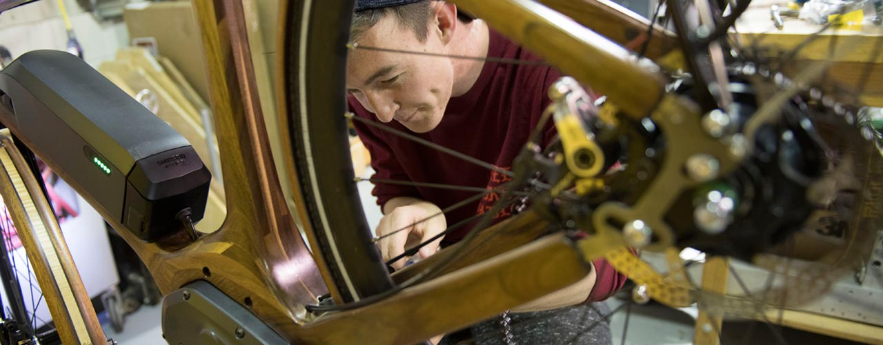 Cedarville mechanical engineering student works on wooden ebike