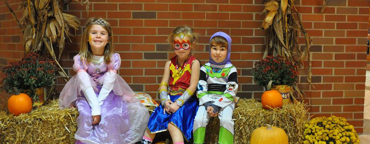 Children show off their costumes during the annual Halloween parade hosted by the Cedarville University bookstore