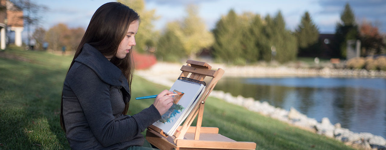 Savannah Hart doing artsy stuff by the lake.