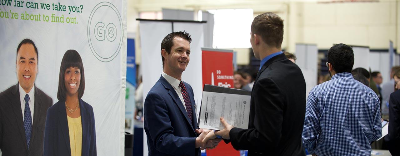 Student talks with recruiter at Cedarville career fair