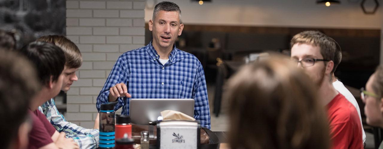 Cedarville University professor Dan DeWitt talks with students
