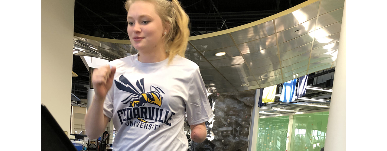 Cedarville University junior Mallory Waayenberg, who has a prosthetic arm, is getting assistance from Cedarville engineering majors developing a 3D attachment that will help her lift weights.