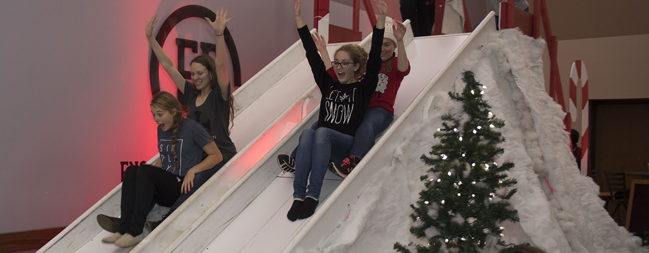 Students glide down giant slides during Cedarville's Campus Christmas
