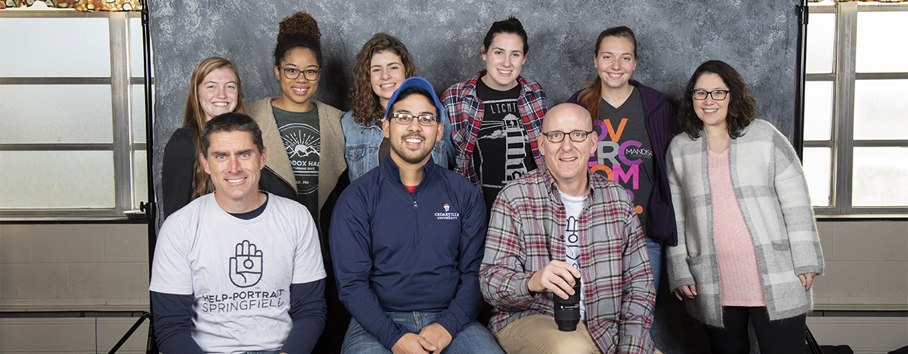 Cedarville University photographer Scott Huck, front row, far right, along with staff and student helpers working at Help Portrait.