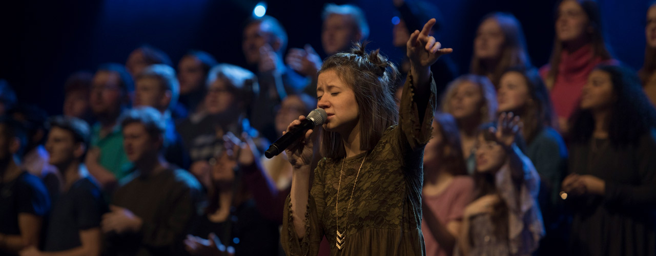 Cedarville student singing with a choir