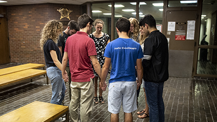 Cedarville University students praying in the lobby at the Clark County Jail in Springfield, Ohio.