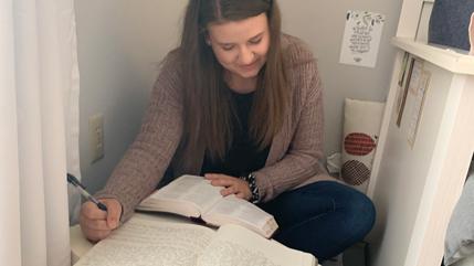Abigail Blain working on her devotional