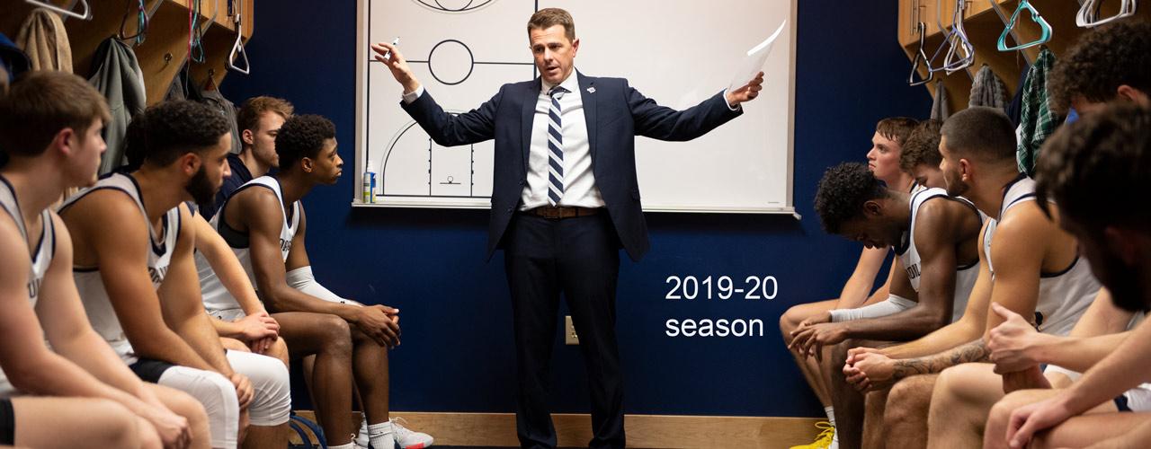 Yellow Jackets men's basketball coach Pat Estepp talking to his team in the locker room