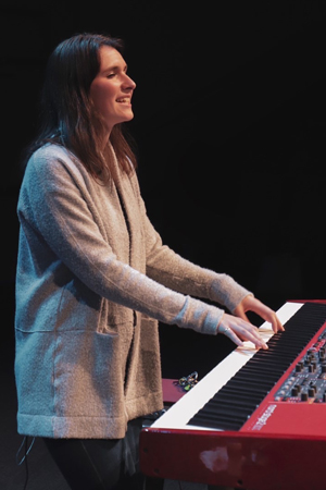 Ariana Brooks plays keys for a 2019 chapel.