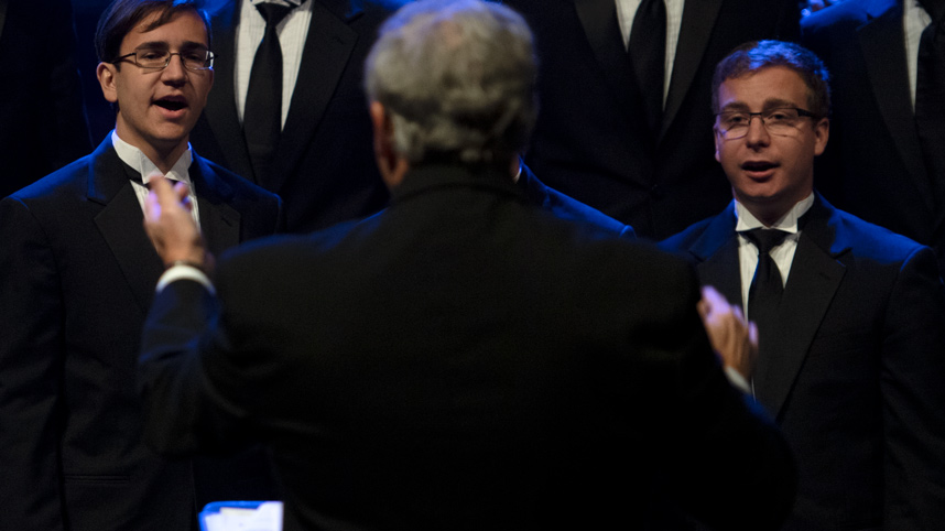 Lyle Anderson leading Men's Glee Club