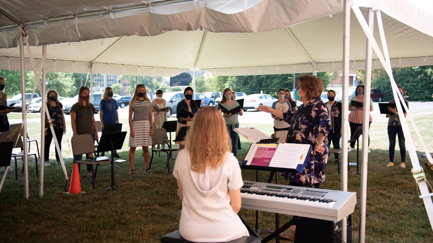 """Dr. Beth Porter teaching an """"in tents"""" music class"""