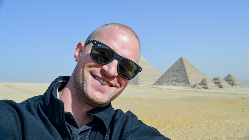 Dr. Matt Bennett with pyramids in the background
