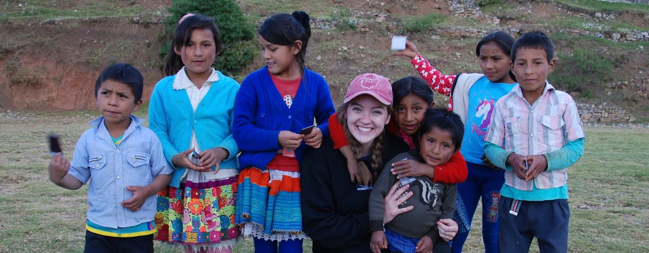 Global Outreach student with kids