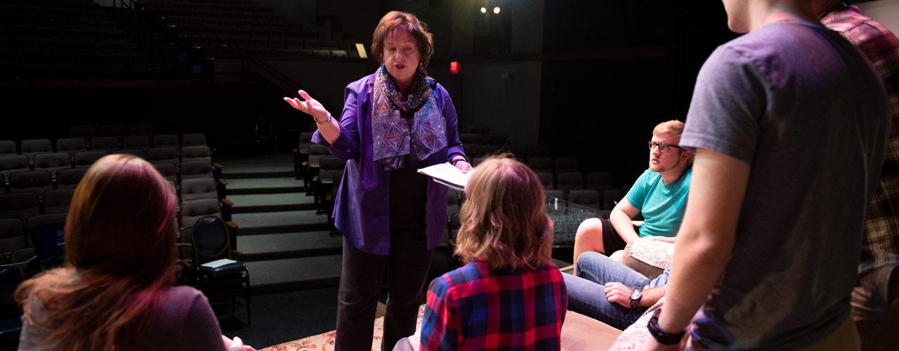 Dr. Diane Merchant speaking with student actors.