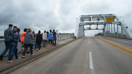 Civil Rights Bus Tour students and faculty walking up the Edmund Pettus Bridge