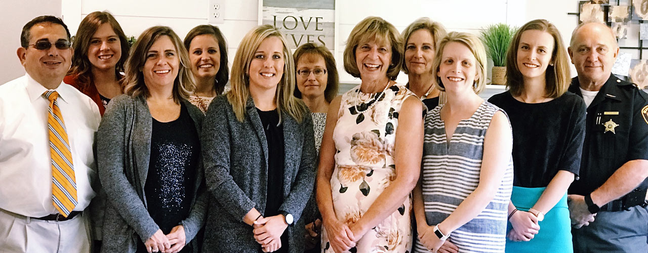 Ohio Governor's wife, Mrs. Fran DeWine, fourth from right (front) and Sandi Wagner, instructor of social work, second from left (back)