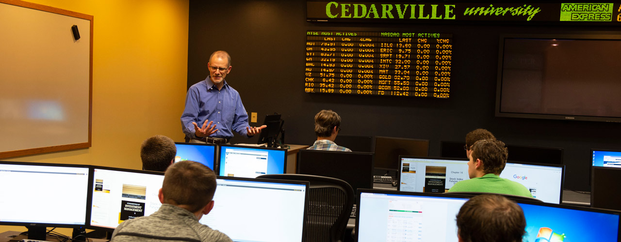 School of Business administration stock ticker room with Dr. Jeff Guernsey