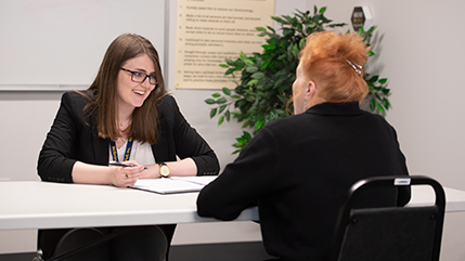 Social work student talking with a client